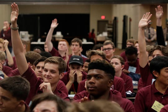 Participants raise their hands to ask a question to Agriculture Commissioner Nikki Friend during the 76th session of the Florida American Legion Boys State at Donald L. Tucker Civic Center Monday, June 17, 2019.