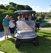 Anna Burklew, left, Elaine Coppola, Miss Hibiscus 2019 Rebekah Parsons, Melanie Coppola, Mary Grace Coppola, Anthony Aversa, Nicholas Coppola and Tim Burklew at the Cole Coppola Memorial Fishing Pier during the raffle drawing for a new golf cart donated by Golf Carts of Vero Beach.