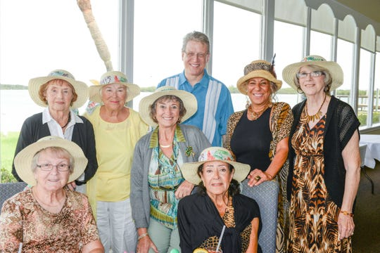 Backus Museum Executive Director J. Marshall Adams, center, with Ocean Village residents, from left, Barbara Boyle, Kathleen Mullen, Margaret Hawke, Maureen Van Name, Lillian Aguiar, Martha Elaina Gilbert and Ginny Handy at the Backus Bingo luncheon June 7 at the Pelican Yacht Club in Fort Pierce.