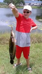 Cam McCullough caught and released a 30-inch, 10-pound bullseye snakehead (or is it a bowfin?) while fishing in a pond in Palm City.