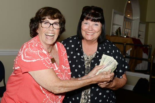 Cleo Stern, left, and Crystal Samuel, the winner of the final cash prize drawing, at the Backus Bingo luncheon June 7 at the Pelican Yacht Club in Fort Pierce.