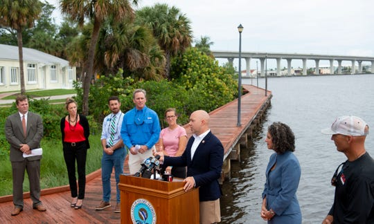U.S. Rep. Brian Mast (third from right) announces he's filing the Prioritizing Revised Operations to Eliminate Cyanobacteria Toxins in Florida Act, or the PROTECT Florida Act, which is a revision of the bill The Stop Harmful Discharges Act, during a news conference Monday, June 17, 2019, along the St. Lucie River in Stuart. Mast was supported by a variety of residents and dignitaries, (from left) Alex Gillen, executive director of the Friends of the Everglades, Kelli Glass Leighton, city of Stuart commissioner, Mike Meier, city of Stuart commissioner, Blair Wickstrom, publisher of Florida Sportsman magazine, Cristina Maldonado, a veterinarian of Stuart, Jacqui Thurlow-Lippisch, South Florida Water Management District board member, and Ed Zyak, a local fishing guide from Jensen Beach.