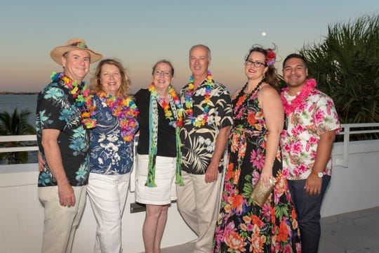 Eric and Karen Kiehn, left, Pam and Duncan Hurd, Sarah Baker and Chris Vega at United Way of Martin County's Tikis on the Terrace at the Mansion at Tuckahoe.