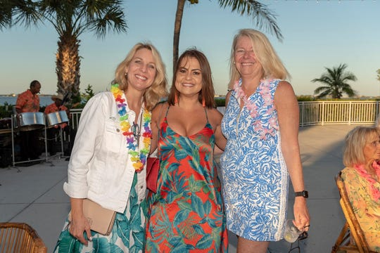 Tammy Matthew, left, Jeruza Kowalski and Michele Reilly at United Way of Martin County's Tikis on the Terrace at the Mansion at Tuckahoe.