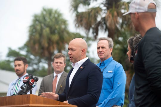 U.S. Rep. Brian Mast announced he's filing the Prioritizing Revised Operations to Eliminate Cyanobacteria Toxins in Florida Act, or the PROTECT Florida Act, which is a revision of the bill The Stop Harmful Discharges Act, during a news conference Monday, June 17, 2019, along the St. Lucie River in Stuart. Mast was supported by a variety of residents and dignitaries, Alex Gillen, executive director of the Friends of the Everglades, Kelli Glass Leighton, city of Stuart commissioner, Mike Meier, city of Stuart commissioner, Blair Wickstrom, publisher of Florida Sportsman magazine, Cristina Maldonado, a veterinarian of Stuart, Jacqui Thurlow-Lippisch, South Florida Water Management District board member, and Ed Zyak, a local fishing guide of Jensen Beach.
