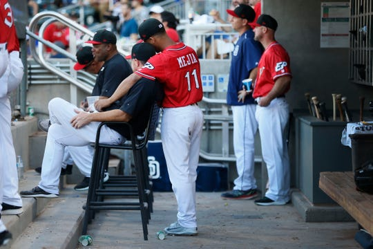 El Paso Chihuahuas' Francisco Mejia leans on hitting coach Morgan Burkhart in the dugout during the game against the Oklahoma City Dodgers Sunday, June 16, at  Southwest University Park in El Paso.