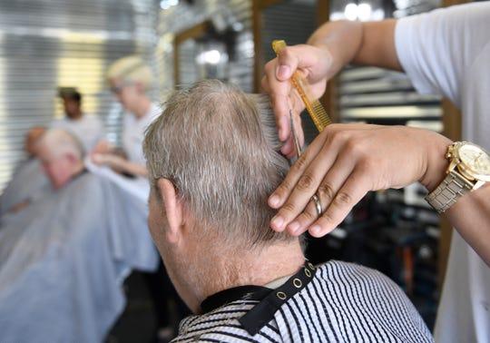 Joseph Velez of Rosario's Barbering gives Joseph Alexander a haircut on Monday, June 17, 2019.