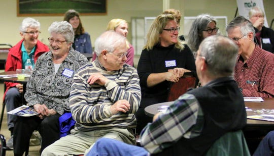 """Participants enjoy a laugh last Wednesday during the Wisconsin Historical Society's """"Share Your Voice"""" listening session for its planned new Wisconsin history museum, held at the Marathon County Historical Society's Woodson Center. The day before the event, one of dozens being held across Wisconsin, the state Legislature's Joint Committee on Finance included $70 million in the 2019-21 capital budget for the new museum, which will be located on the Capitol Square in Madison and replace the current Wisconsin Historical Museum."""