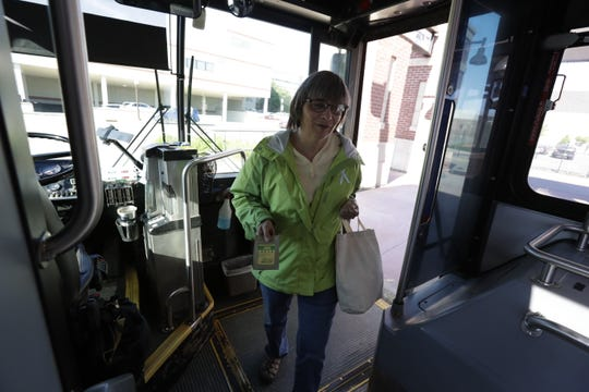 "Kathi Zoern boards the ""G"" bus Monday, June 16, 2019, at the Metro Ride transit in downtown Wausau, Wis. T'xer Zhon Kha/USA TODAY NETWORK-Wisconsin"