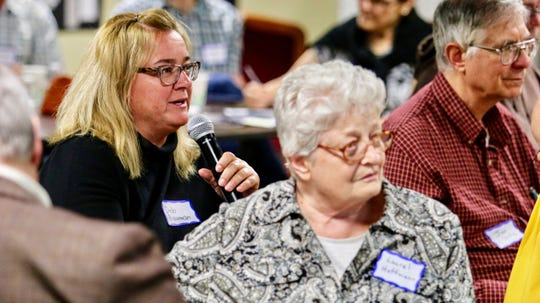 """Wausau elementary school teacher Deb Bauman asks a question about how much room would be available for students in one of the theater areas of a new Wisconsin state history museum that the Wisconsin Historical Society is planning to build on the Capitol Square in Madison. Bauman was one of many local residents attending the Society's """"Share Your Voice"""" new museum listening session Wednesday, June 12, 2019 at the Marathon County Historical Society's Woodson Center in Wausau."""
