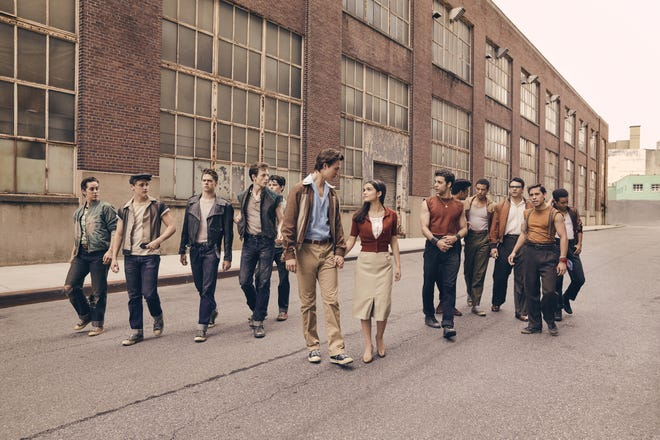"Ansel Elgort, center, as Tony, with Clifton's Rachel Zegler, as Maria, in the first image released from Steven Spielberg's remake of ""West Side Story,"" now in production for a Dec. 18, 2020 release. Others pictured, from left are: Jets members Anybodys (Ezra Menas), Mouthpiece (Ben Cook), Action (Sean Harrison Jones); Jets leader Riff (Mike Faist); Baby John (Patrick Higgins); Tony (Ansel Elgort) and Maria (Rachel Zegler); Maria's brother and Sharks leader Bernardo (David Alvarez); and Sharks members Quique (Julius Anthony Rubio), Chago (Ricardo Zayas), Chino (Josh Andrés Rivera), Braulio (Sebastian Serra) and Pipo (Carlos Sánchez Falú)."