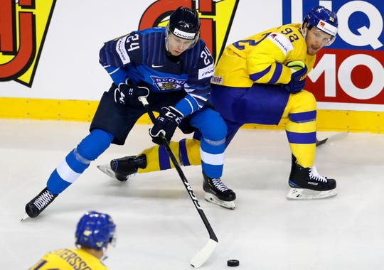 Kaapo Kakko controls the puck during the Ice Hockey World Championships.