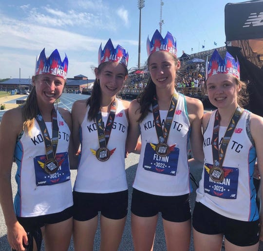 (L-R) Ursuline's Lily Flynn, Claire Wilson, Sarah Flynn and Haley McLean after winning bronze at 2019 New Balance Outdoor Nationals to become All-Americans.
