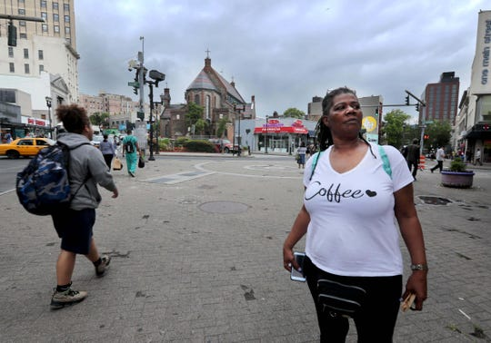 Joanne Roberts of Yonkers says that she is a former client of the Sharing Community Soup Kitchen and Homeless Shelter, located at St. John's Episcopal Church, seen at rear. Roberts, photographed June 17, 2019, says that she would get food from the food shelter and also use their services to try to and find a place to live. She believes that the closing of the shelter at the end of June will lead to far more homeless people on the streets of downtown Yonkers.
