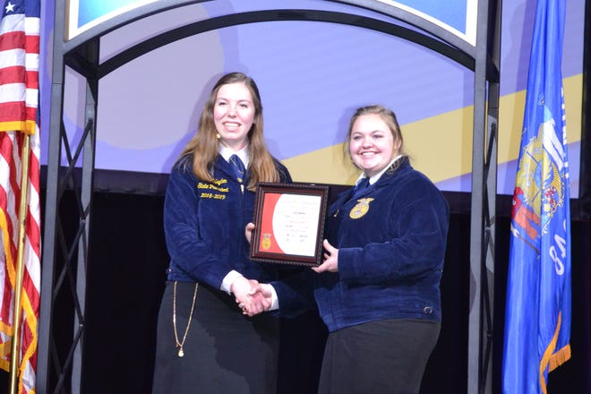 Alex Van Buren (right) of the Waupun FFA Chapter was among 328 FFA members receiving their State FFA Degree, the highest honor at the state level, during the Wisconsin State FFA Convention held in Madison.