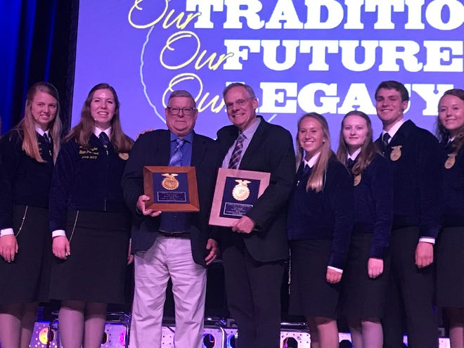 Ag teacher Gordie Gasch (left) and longtime farm broadcaster Mike Austin were selected to receive the prestigious VIP citation during the Wisconsin FFA Convention.