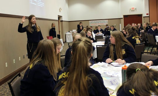 Wisconsin Future Farmers of America 2018-19 President Amelia Hayden works with FFA members at a workshop. Throughout the year, state officers facilitate workshops and conferences for thousands of FFA members. These provide opportunities for students to learn more about leadership development and prepare for career success.