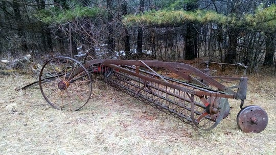 Farm machinery like this side-delivery rake, provided an easier way to make hay for the Apps family.
