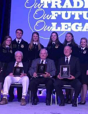 Ken Natzke (seated from left), Jerry Sherwin and Jerry Wendt were inducted into the FFA Hall of Farm during the Wisconsin FFA Convention in Madison.