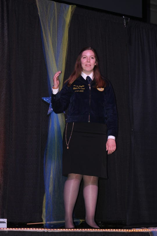 2018-19 State Officer Team President Amelia Hayden addresses the crowd during the sixth session of the 90th annual Wisconsin FFA Convention in Madison.
