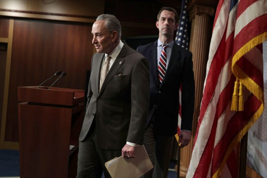 From left, Senate Democratic leader Chuck Schumer of New York and Sen. Tom Cotton, R-Ark.