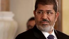 In this July 13, 2012 photo, Egyptian President Mohammed Morsi holds a news conference with Tunisian President Moncef Marzouki, at the Presidential palace in Cairo, Egypt. On Monday, June 17, 2019, Egypt's state TV said that the country's ousted President Mohammed Morsi has collapsed during a court session and died.