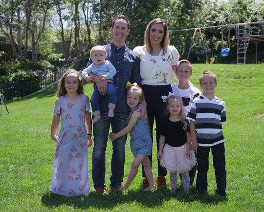 Jordan and Bubba Page with their six children at their home.
