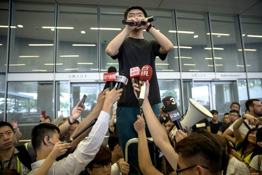 Pro-democracy activist Joshua Wong talks to the media after being released from prison, in Hong Kong, on June 17, 2019.