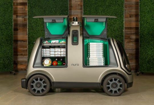 Nuro has developed a custom unmanned vehicle, called the R2, for delivering goods including food and dry cleaning.