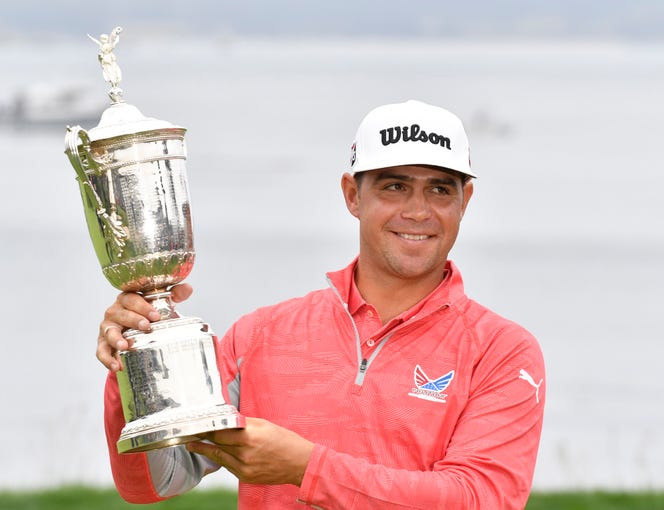June 16: Gary Woodland poses with the championship trophy after winning the U.S. Open.