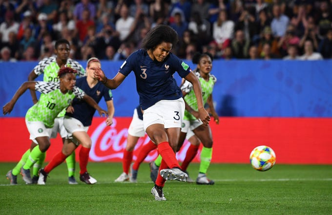 June 17: France's Wendie Renard scores on her second penalty kick after video replay ruled Nigeria's goalkeeper came off her line to make a save on the first attempt. France beat Nigeria 1-0 to win Group A.