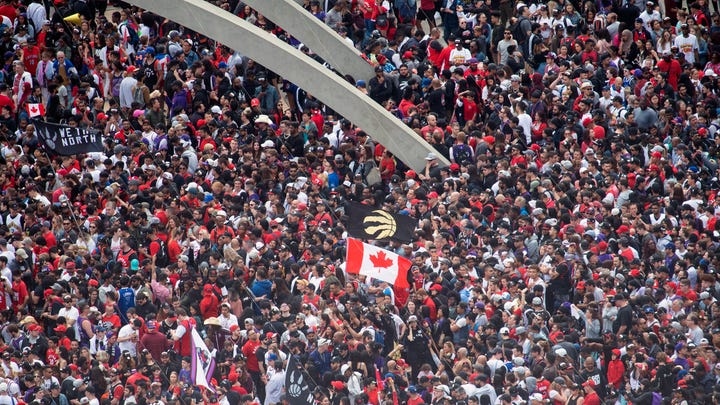 Fans pack Nathan Phillips Square at City Hall ahead of the Toronto Raptors' championship parade.