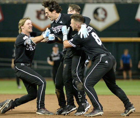 June 16: Mississippi State's Marshall Gilbert (center) celebrates with teammates after driving in the winning run against Auburn. Mississippi State won the game, 5-4.