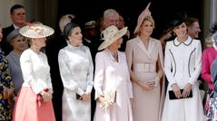 From left, Sophie Countess of Wessex, Queen Letizia of Spain, Camilla Duchess of Cornwall, Queen Maxima of the Netherlands and Kate Duchess of Cambridge, stand together as they watch the annual Order of the Garter Service at St. George's Chapel at Windsor Castle, June 17, 2019.