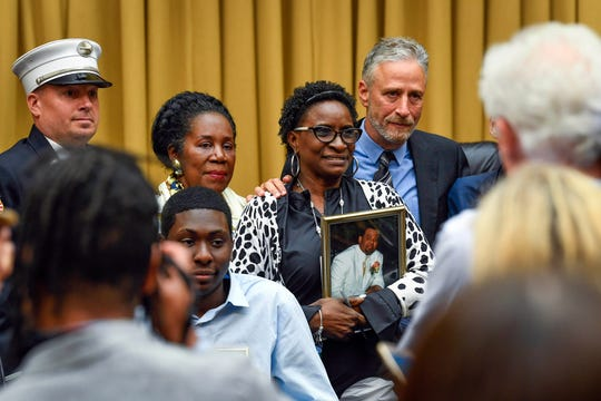 Jon Stewart next to Anesta Maria St. Rose Henry, whose husband helped clear Ground Zero in 2001, at the congressional hearing on June 11, 2019.