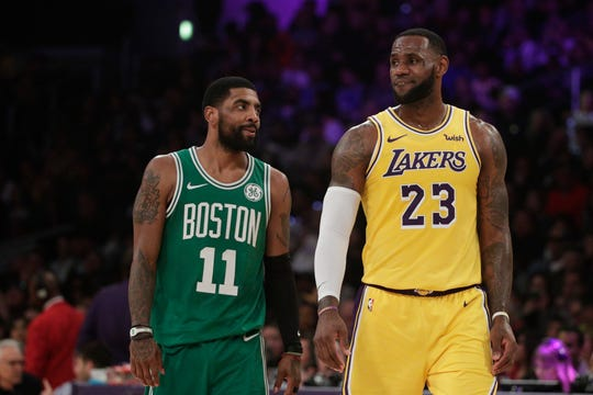 Los Angeles Lakers' LeBron James, right, and Boston Celtics' Kyrie Irving chat during the first half of an NBA basketball game, Saturday, March 9, 2019, in Los Angeles. (AP Photo/Jae C. Hong) ORG XMIT: NYOTK