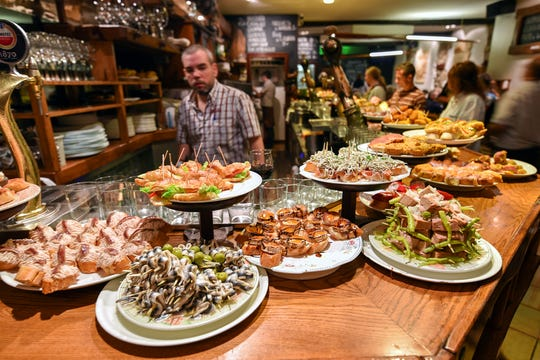 At Basque-style tapas bars, pintxos are already laid out, so you can simply point to or grab what you want. (photo: Cameron Hewitt)