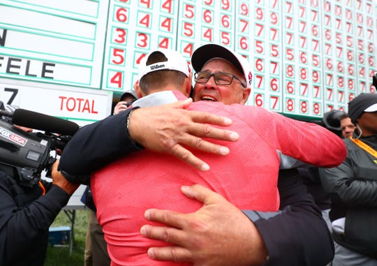 Gary Woodland hugs his father Dan after winning the U.S. Open.