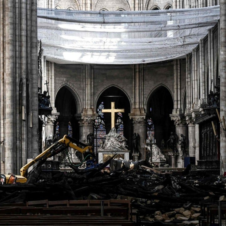 Worshippers wear hard hats for first Notre Dame mass since fire
