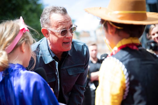 "Tom Hanks greets young fans at the London premiere of ""Toy Story 4."""