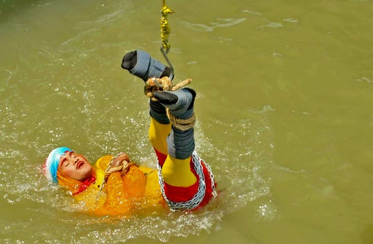 An Indian magician who went missing after being lowered into a river tied up in chains and ropes in a Houdini-inspired stunt is feared drowned, police said June 17.