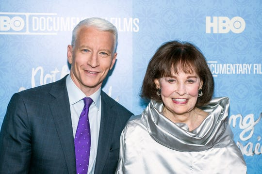 """Anderson Cooper and Gloria Vanderbilt attend the premiere of """"Nothing Left Unsaid"""" at the Time Warner Center on April 4, 2016, in New York City."""
