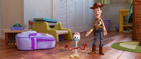 "Woody (right, voiced by Tom Hanks) welcomes Forky (Tony Hale) to the gang in ""Toy Story 4."""