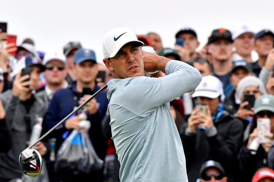 Brooks Koepka plays his shot from the ninth tee during the final round of the U.S. Open.