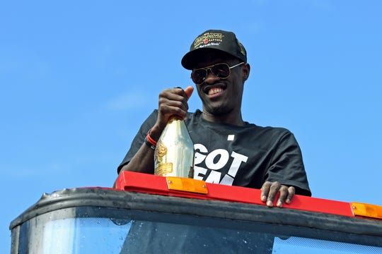 Raptors forward Pascal Siakam celebrates with a bottle of champagne.