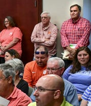 Attorney Kurt Tavernier, upper right, listens in during an Anderson County School District 2 special-called meeting at the district office in Honea Path Monday, June 17, 2019.