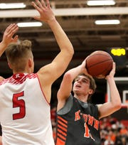 Kaukauna's Keaton Ferris puts up a shot against Kimberly during a game in December.