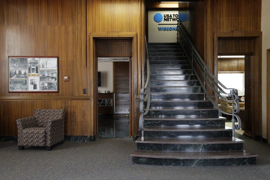The lobby of The Post-Crescent building features a red marble and green granite staircase.