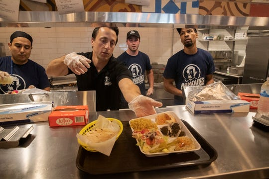 Hussam Chater of Spring Lake and Mamoun's CEO helps in the kitchen during the lunchtime rush. Mamouns, a chain featuring Middle Eastern food, has opened a restaurant in Wall on Route 35.