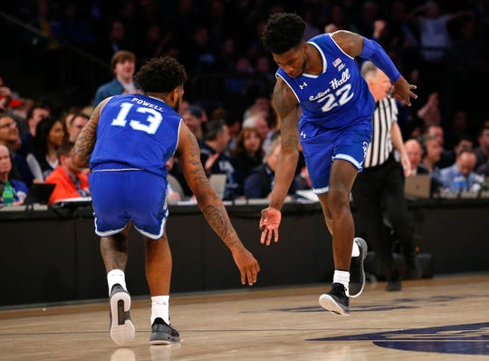 Seton Hall Pirates guard Myles Cale (22) celebrates with guard Myles Powell (13) after making a three point shot against the Villanova Wildcats  during the second half in the Big East conference tournament final